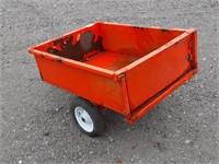 Orange tilt deck garden tractor trailer