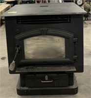 Pellet burning stove with electric fan