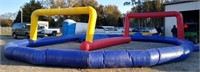 Blow up race track with blow up horse and two