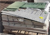 Pallet of composite siding. Green and tan colored
