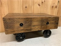 Exceptional Barn Beam Bench on Cast Wheels