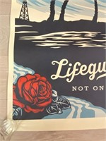 "Signed ""Lifeguard Not on Duty"" Obey"