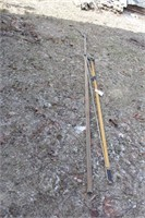 2 wood shafted pruning poles