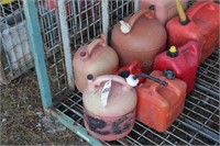 8 gas cans - ranging from 2 to 5 gallons - i