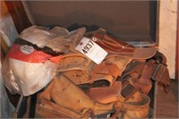 trunk full of tool belts, holsters & safety equip