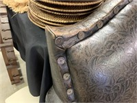 LEATHER TOOLED ARM CHAIR W SHOTGUN SHELL ACCENTS