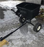 Pull agri fab behind yard fertilizer