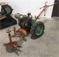 Orange and Green brush mower with Wisconsin 5hp