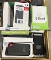 Lot of phone cases, battery chargers, and screen