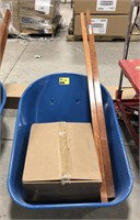 New wheel barrel with parts in box