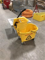 Utility  sink and mop bucket on wheels