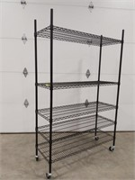 Wire shelving unit adjustable on wheels
