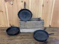Group of Cast Frying Pans and Old Box