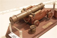 "Ship's cannon - 8"" long on wood display base"