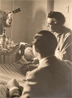 Photo of Robert Capa, Burl Ives, and John Huston