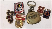 Collection of small Olympic Pins and Coca Cola