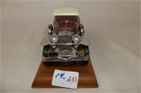 1930 Duesenberg J Derham Tourster on Display Board