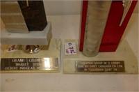 2 Champion Steer Trophies
