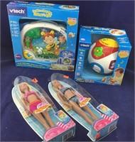 Boxed Pr of Barbies + Boxed Vtech Infant Items