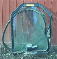 cab door for a Bobcat G-Series skid loader,