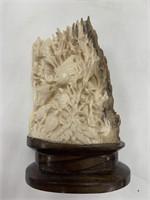 Mammoth ivory carving signed Yogi on a hardwood ba