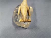 "Imported 2.5"" Whale carved from antler, on a cryst"