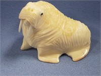 """2.5"""" Carved ivory walrus with inset baleen eyes"""