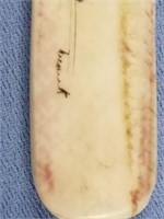 Scrimmed ivory letter opener with dog team on foss