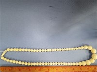 Graduated ivory bead necklace, overall length is 2