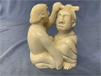 "Ivory carving ""Shaman torturing a witch, witch is"