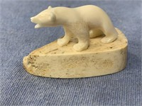 "1.25"" Ivory bear by Leonard Savage on a bone base,"
