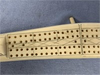 "Scrimmed ivory cribbage board 16.5"" long, with sea"