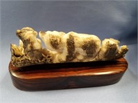 Fossilized ivory carved bear family by Michael Sco