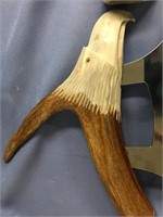 Ulu knife, antler handle carved in the shape of an