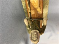 Soapstone and hardwood carving of a kayaker with h