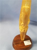 fossilized ivory artifact with relief  carving of