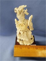 Beautiful ivory carving of a Japanese women, on el