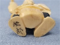 "Ivory Netsuke of a craftsman, approx. 2""        (i"