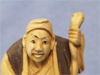 "Ivory Netsuke of a man holding a snake, approx. 2"""