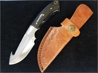 Hunting knife with horn handle, gut hook, leather