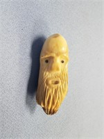 Walrus ivory tooth of a man by Dennis Pungowiyi