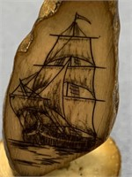 Michael Scott scrimshaw of a sailing ship on fossi
