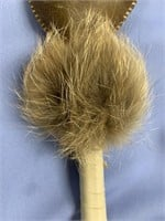 A baby rattle, with hand shaped rattle made from S