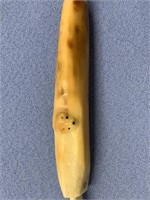 Fossilized Ivory olive fork with a tiny carved fox