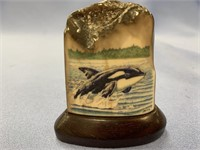 Color scrimshaw of a killer whale on fossilized iv