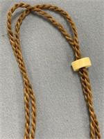 Traditional Hawaiian Ivory fish hook on corded lan