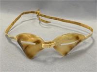 Pair of white baleen eskimo snow goggles, signed b