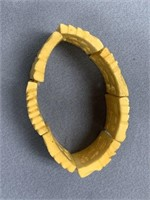 Fossilized bone stretch bracelet, depicting variou