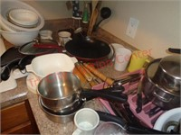 Lot of small kitchen appliances, utensils, dishes