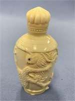 Lovely hand carved bone snuff bottle, featuring pi